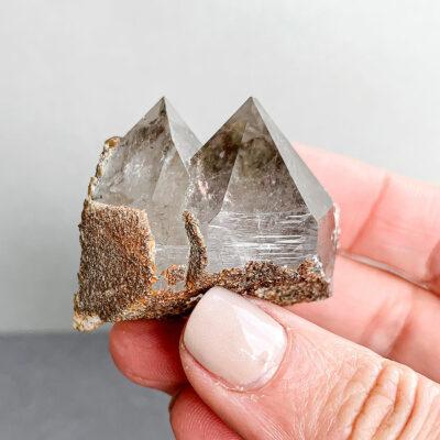 ponta de quartzo fumado surya cristais
